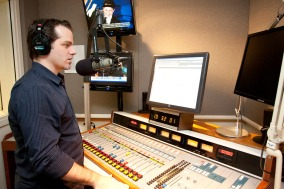 Tyler Moody at the board at CNN Radio