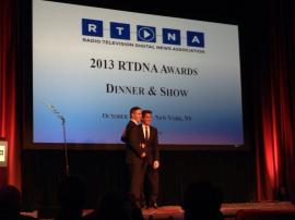 Steve Kastenbaum accepting a Murrow Award for CNN Radio from David Muir.